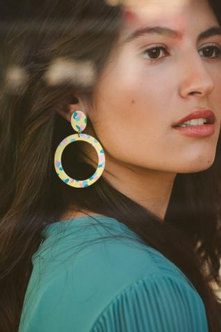 Model wearing yellow hoop earrings windo