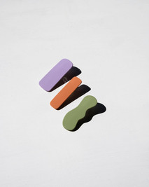 Colorful hair clips on white background.