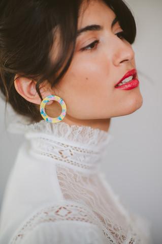 Model wearing yellow circle stud earring