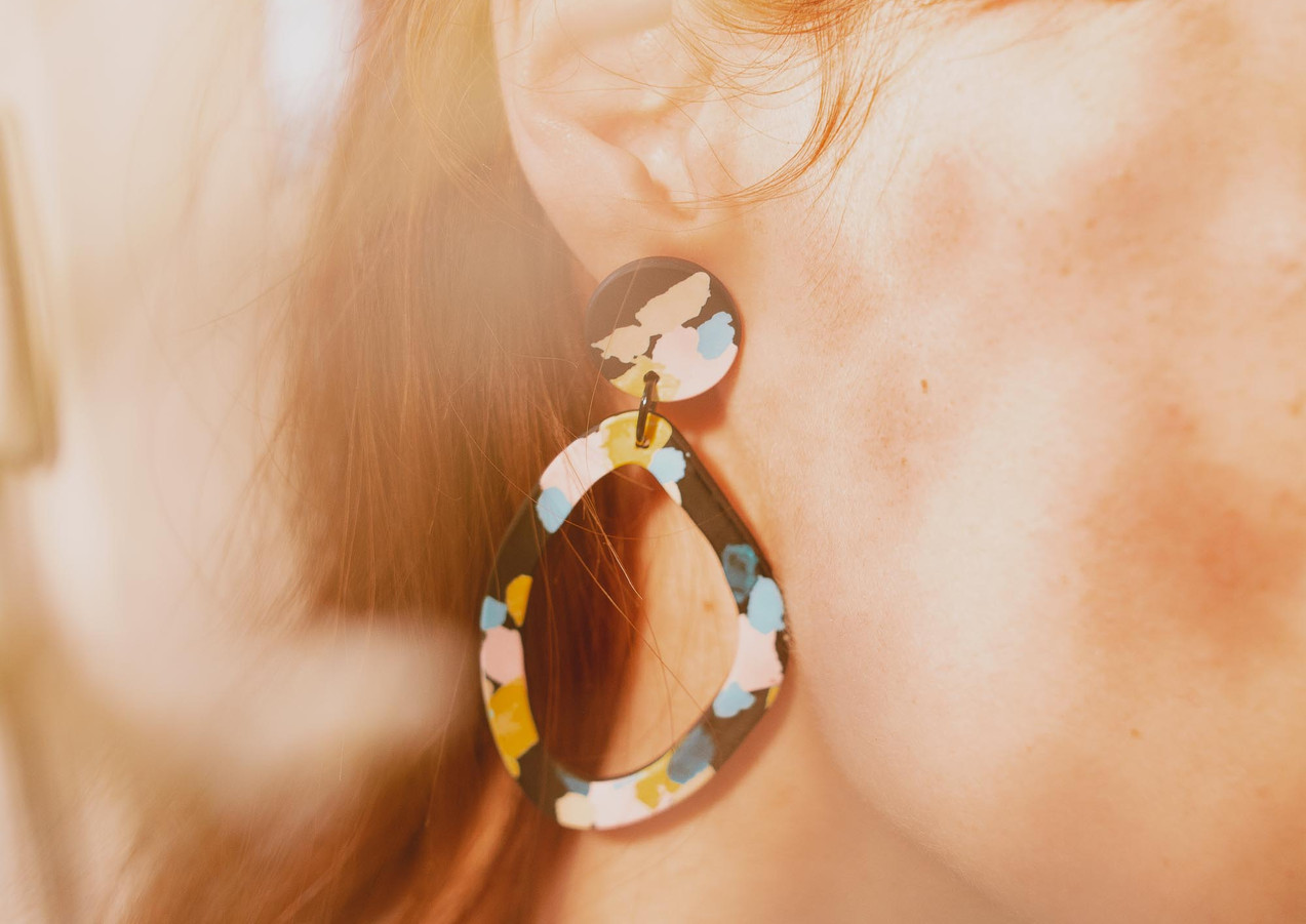 Colorful asymmetric hoops on a model.jpg