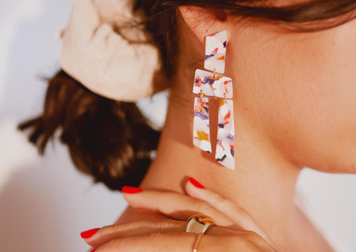 Side view of drop earrings on a model.jp