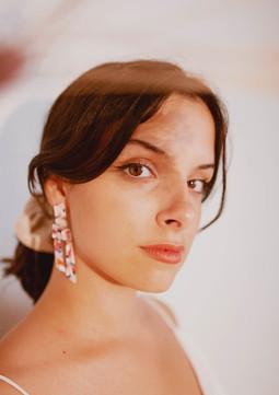 Semi translucent earrings on a model.jpg