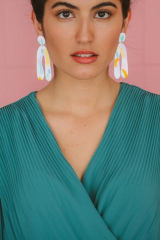 Model wearing large statement drop earri
