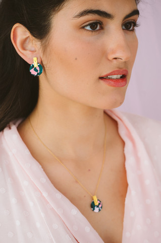 Model wearing gold-plated set of earring