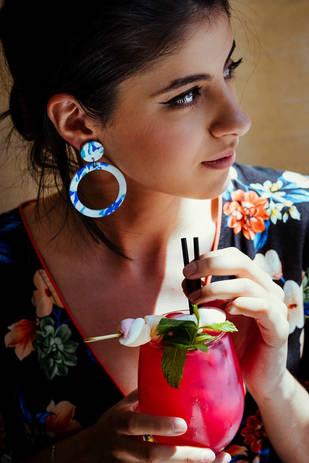 Model wearing blue statement earrings dr