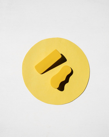 Yellow hair clips on yellow background.j
