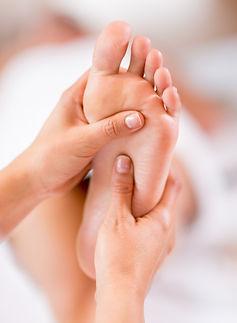 Close up of a foot massage at the spa .j