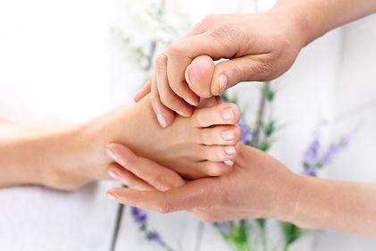 Relaxing Thai foot massage. Masseuse mas