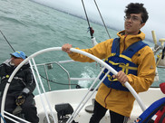 Crew Leader Dylan Smith at the Helm