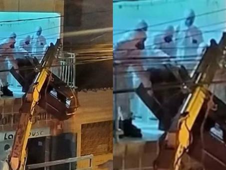 Corpo de homem com Covid-19 é retirado por varanda de apartamento