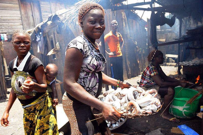 A girl carries smoked fish at Makoko shanty town in Lagos on Aug. 30, 2012.