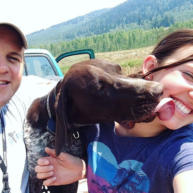 Clancy was so excited about our family camping trip he kept trying to steal kisses from mom!