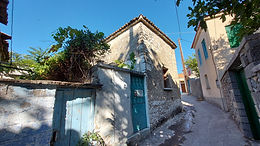 Traditional stone house with yard for sale in Eressos