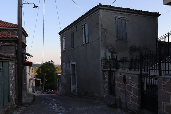 A two storey stone house with sea view and large yard is for sale in Eressos