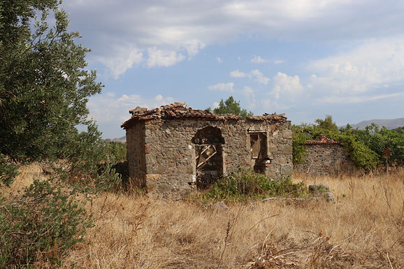 For sale in Skala Eressos a plot of land with a house to be repaired