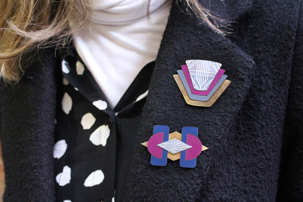 art deco brooches in use.png