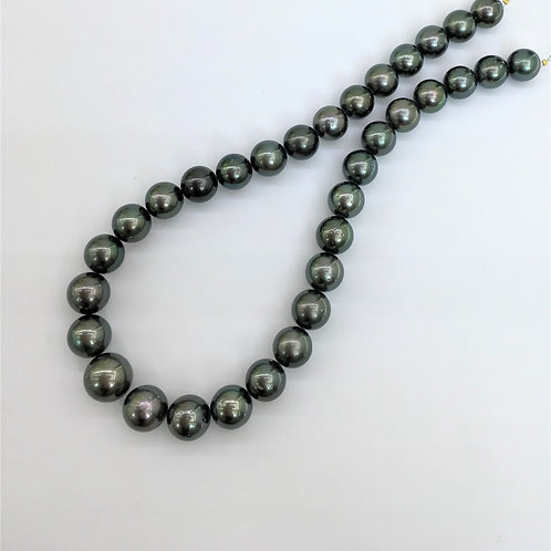 A set of Dark Tahitian Pearl necklace & earrings