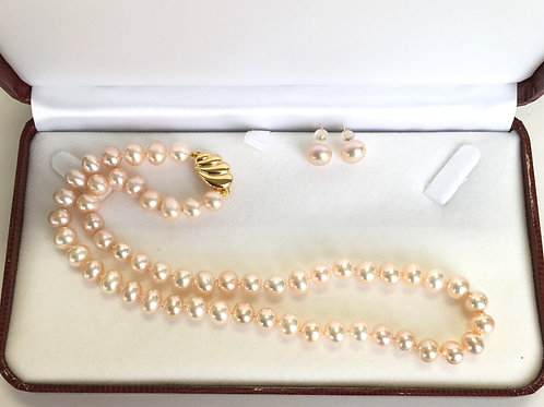 A set of peach color Pearl necklace and earrings