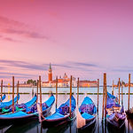 Gondolas in Venice at sunrise with San G