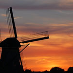 Beautiful dutch windmill at sunset