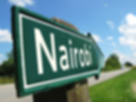 Nairobi signpost along a rural road.jpg