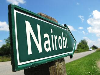 Nairobi signpost along a rural road.jpg