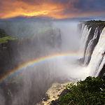 Victoria Falls sunset with rainbow, Zamb