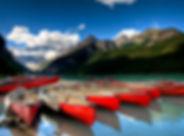 canoes on beautiful tourquoise lake.jpg