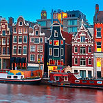Night city view of Amsterdam canal, typi