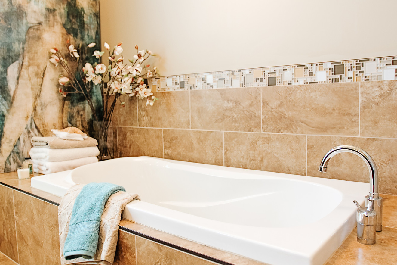 Master soaker tub spa master bath designed by Room Service Interiors in Cochrane and Calgary AB