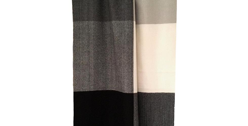 checkered in black , grey and cream blocks