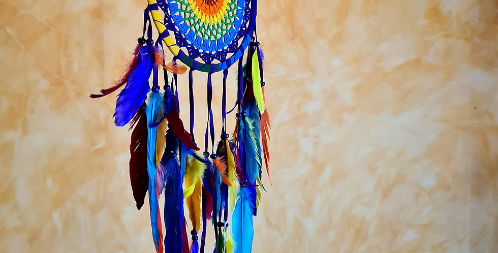Rainbow coloured yarn and feathers. A vertical hanging ring with feathers hanging from  bottom half. Handmade and Fairtrade.