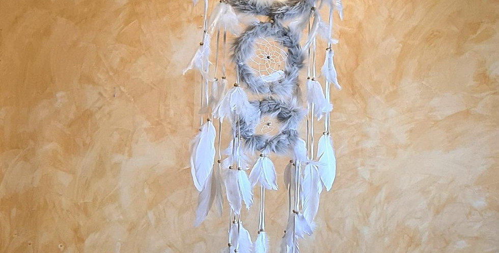 Large Native American Dreamcatcher. 3 Rings covered with fur and leather strings with feathers hanging from it.