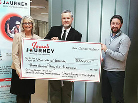 Jesse's Journey present Patrick Gunning and the group with a $300,000 grant.