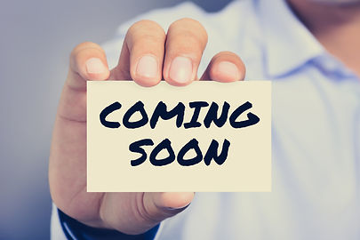 COMING SOON message on the card held by
