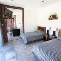 Habitación con dos camas individuales de apartamento de un piso.