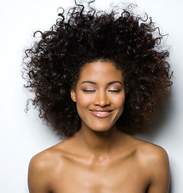 Portrait of a Smiling Woman with Curly H