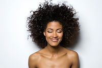 Portrait of a Smiling Woman with Curly Hair