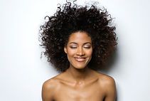 A woman's relaxed smiling face implicates a comfortable acupuncture treatment by Naomi Takazawa Welch of TAKAZAWA ACUPUNCTURE.