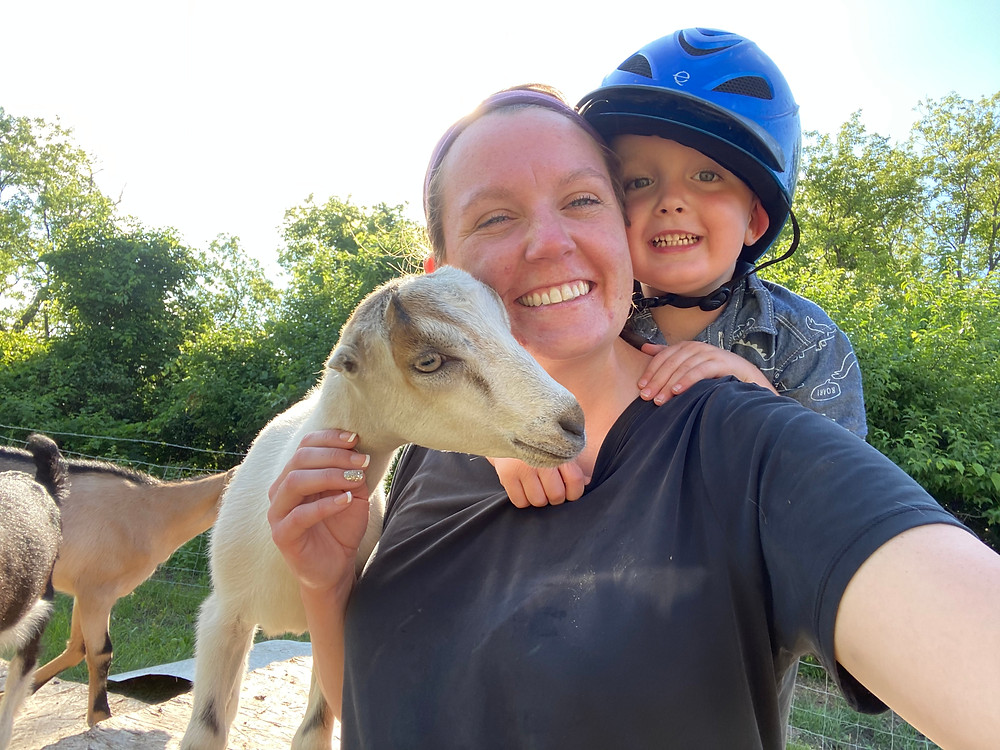 A goat, a woman, and a child