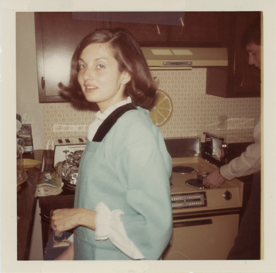 Fresh faced girl in the kitchen 1960's