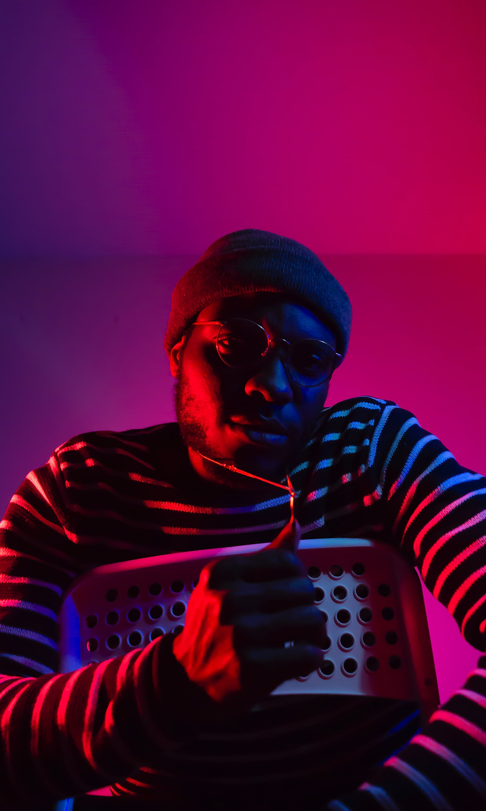 black male model in red neon lighting