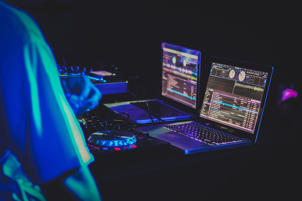 DJ equipment in neon lights at a party
