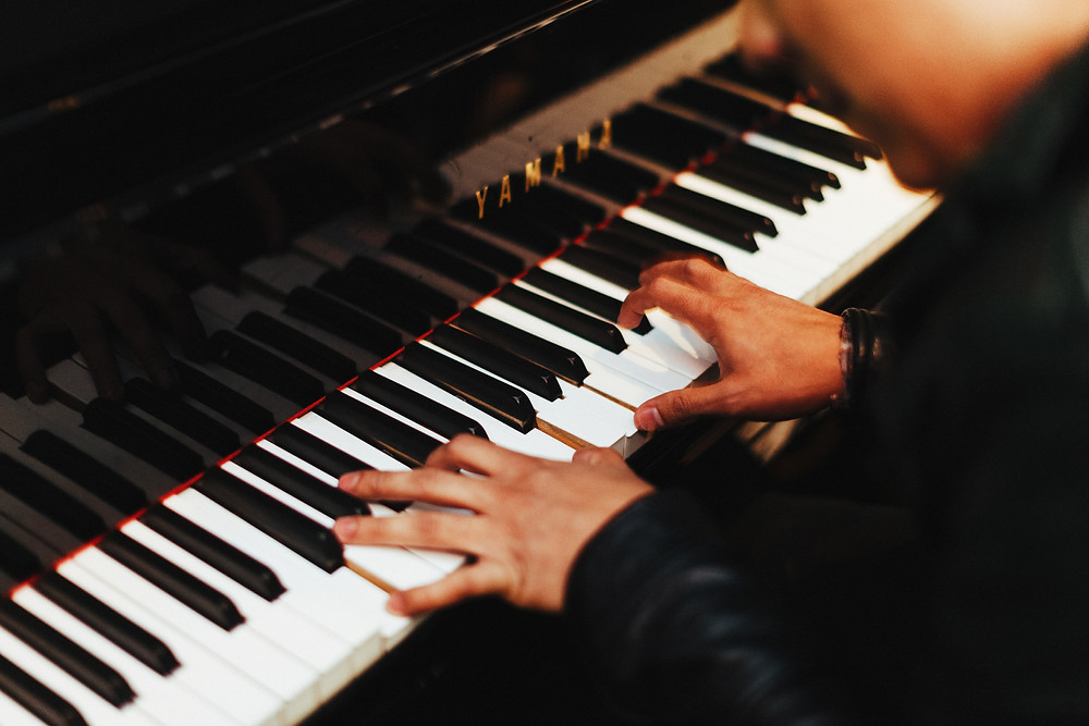 Man playing Yamaha piano