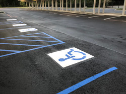 Evans Asphalt and Concrete seal coat repair stripe ada handicap parking lot patch