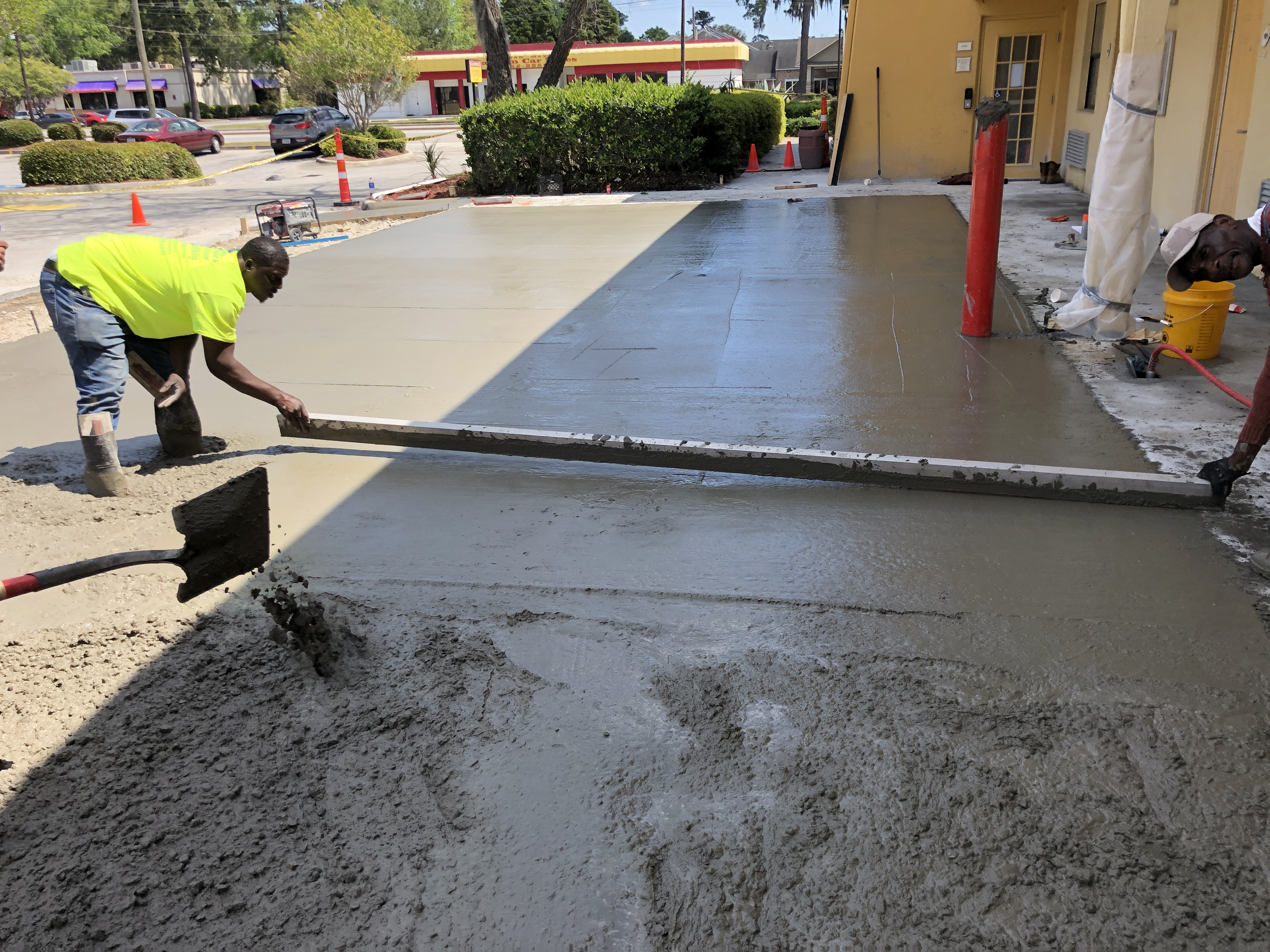 Screeding concrete after pouring