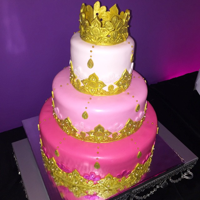 3 tiered fuchsia and Gold wedding cake.