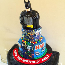 Two-tiered Batman and the Joker cake.  Www.Specialtysweetc