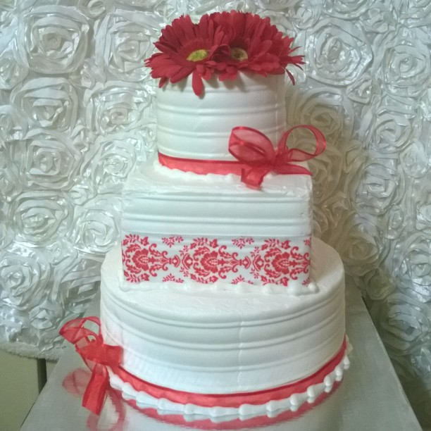 3 tiered red and white celebration cake. Www.specialtysweetc