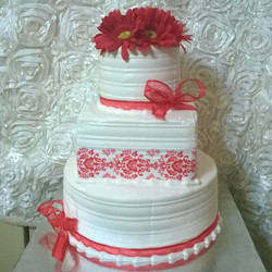 3 tiered red and white celebration cake